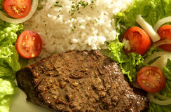 STEAK, RICE AND SALAD Royalty Free Stock Photo
