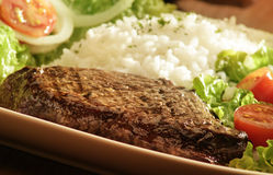 Steak, rice and salad. A close up cropped image shot from above of steak rice and salad Stock Image