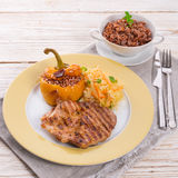 Steak with rice stuffed peppers Stock Photos