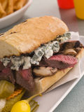 Steak and Roquefort Sandwich with Fries Gherkins Stock Photography