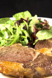 Steak and salad. Close up of a juicy steak with salad garnish Royalty Free Stock Image