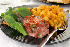 Steak and salad. A stuffed flank steak with spinach salad and macaroni and cheese Stock Image