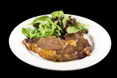 Steak and salad. Cooked steak with salad on a white plate Stock Photo