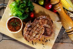Steak with salad. Spice on block Royalty Free Stock Image
