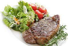Steak and Salad. Grilled steak with salad.  Porterhouse or New York strip steak, grilled, with rosemary Royalty Free Stock Photography