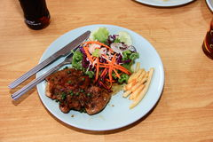 Steak and salad. In the dish Royalty Free Stock Images