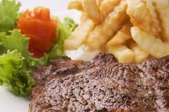 Steak, salad and french fries Stock Photography