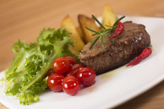 Steak with salad Royalty Free Stock Images