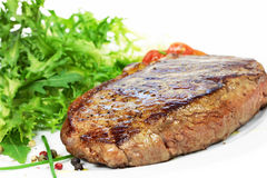 Steak and salad. Grilled steak and salad on plate Stock Photography