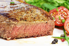 Steak and salad. Grilled steak and salad on plate Stock Images