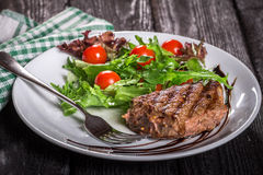 Steak and salad on a plate. Steak with salad on the plate Stock Photo