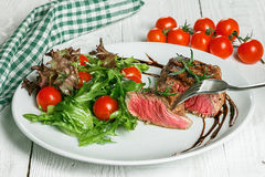 Steak and salad on a plate. Steak with salad on the plate Royalty Free Stock Photography
