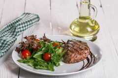 Steak and salad on a plate. Steak with salad on the plate Royalty Free Stock Images