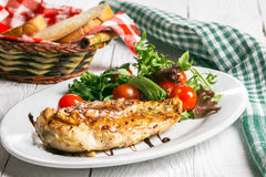 Steak and salad on a plate. Chicken steak with salad on the plate Royalty Free Stock Images