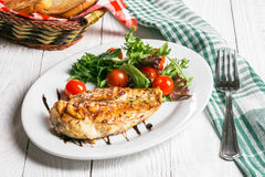 Steak and salad on a plate. Chicken steak with salad on the plate Royalty Free Stock Photography