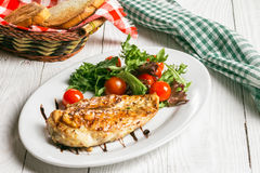 Steak and salad on a plate. Chicken steak with salad on the plate Stock Photos