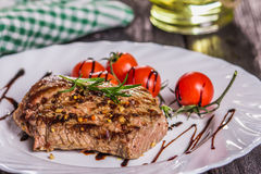 Steak and salad on a plate. Fried steak on the plate with salad and vegetables Royalty Free Stock Image