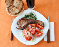 Steak with salad, served with bread and drink Royalty Free Stock Images