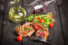 Steak and salad. On a wooden table Stock Photography