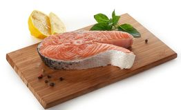 Steak of salmon with basil and lemon Stock Photography