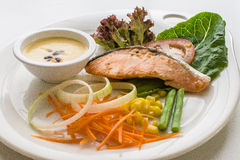 Steak salmon with fresh vegetable ingredients, herbs Top view. Stock Photos
