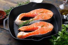 Steak Salmon on a grill pan. Cooking Red Fish Stock Photography