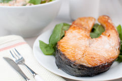 Steak of salmon with spinach and salad Royalty Free Stock Photo