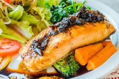 Steak salmon. Salmon steak in white dish with vegetables Stock Images