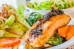Steak salmon. Salmon steak in white dish with vegetables Royalty Free Stock Photo