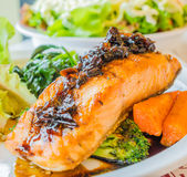Steak salmon. Salmon steak in white dish with vegetables Royalty Free Stock Photography