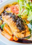Steak salmon. Salmon steak in white dish with vegetables Royalty Free Stock Image
