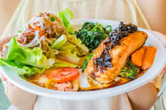 Steak salmon. Salmon steak in white dish with vegetables Royalty Free Stock Photos