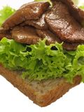 Steak sandwich. Delicious beef steak and lettuce sandwich Royalty Free Stock Photography