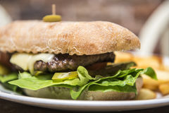 Steak sandwich in a ciabatta bread wwith chips Royalty Free Stock Photos