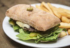 Steak sandwich in a ciabatta bread wwith chips Royalty Free Stock Image