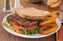 Steak sandwich. A cube steak sandwich on sprouted whole grain and seed bread stock photos