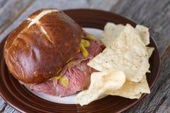 Steak Sandwich with Pretzel Bun Royalty Free Stock Images