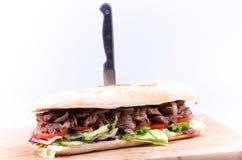Steak sandwich with stabbed knife. Steak long sandwich with stabbed knife Stock Photography