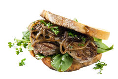 Steak Sandwith with Onions over White. Steak sandwich with onions and spinach, over white background Royalty Free Stock Photography