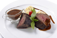 Steak with sauce Royalty Free Stock Photos