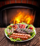 Steak, sausage and vegetable on a plate Stock Photo