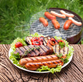 Steak, sausage and vegetable Royalty Free Stock Images