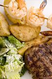 Steak and Seafood with caesar Royalty Free Stock Photography