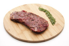 Steak seasoned Stock Photography
