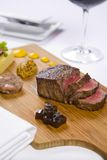 Steak Served On Wooden Tray With Condiments Stock Image