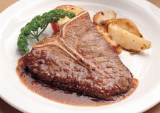 A steak served with potatoes Royalty Free Stock Photo