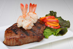 Steak and shrimp. Tasty, delicious plate of grilled steak and boiled shrimp Royalty Free Stock Photos