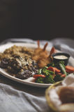 Steak and Shrimp Dinner. With brown rice and mixed vegetables Royalty Free Stock Photography