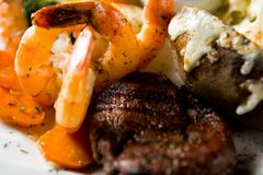 Steak and shrimps Stock Images