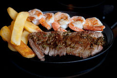 Steak shrimps french fries  skillet Stock Image